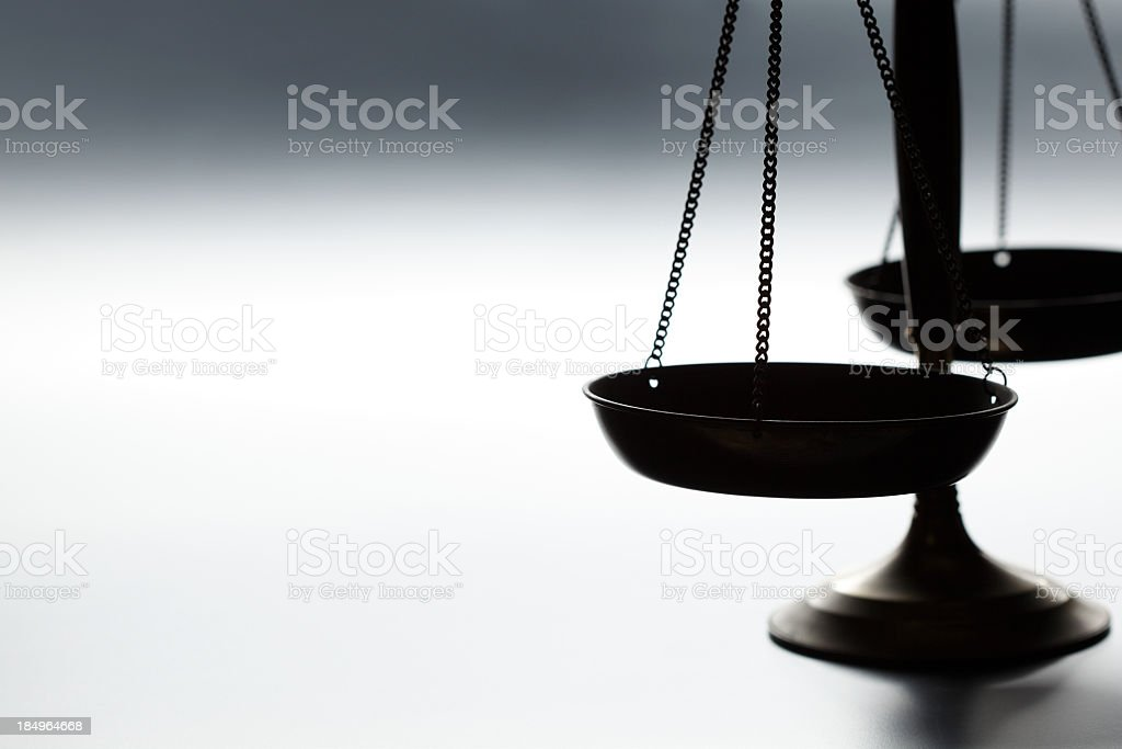 Lone justice scale on simple gray background stock photo