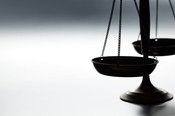 lone justice scale on simple gray background - scale stock photos and pictures