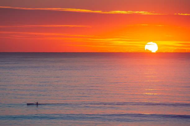 Lone Kayak at sunrise on the Gold Coast stock photo