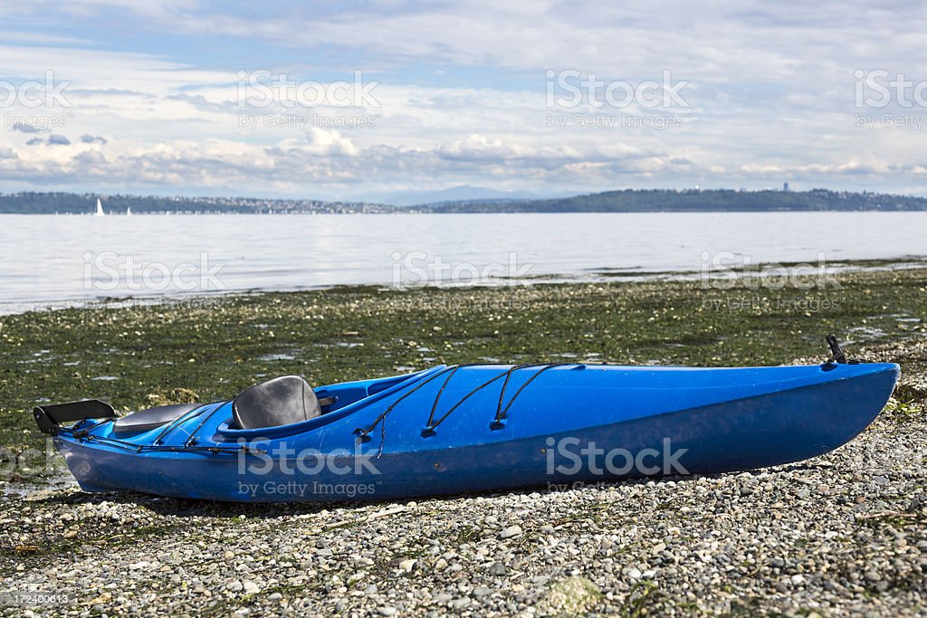 Lone Kayak on a stony beach royalty-free stock photo