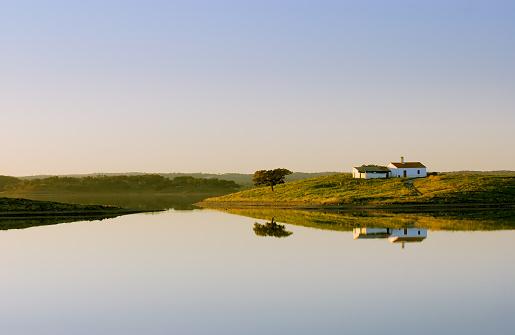 Island on the lake with rural house, Alqueva dam, Beja, Alentejo, Portugal