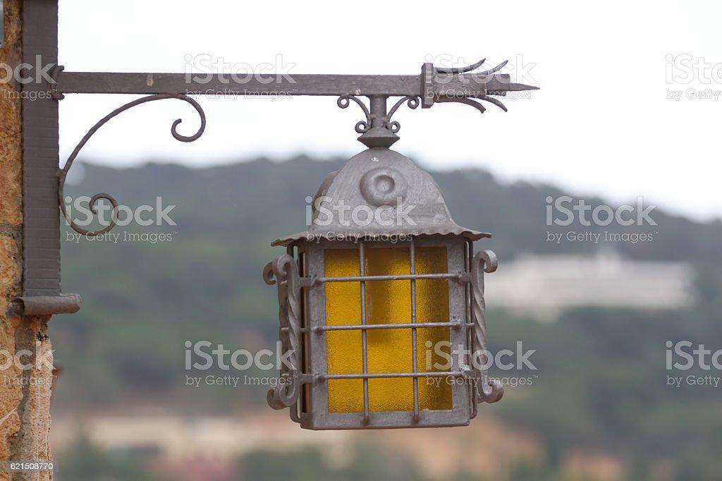 Lone lantern illuminates Costa Brava. The metal lamp Lizenzfreies stock-foto