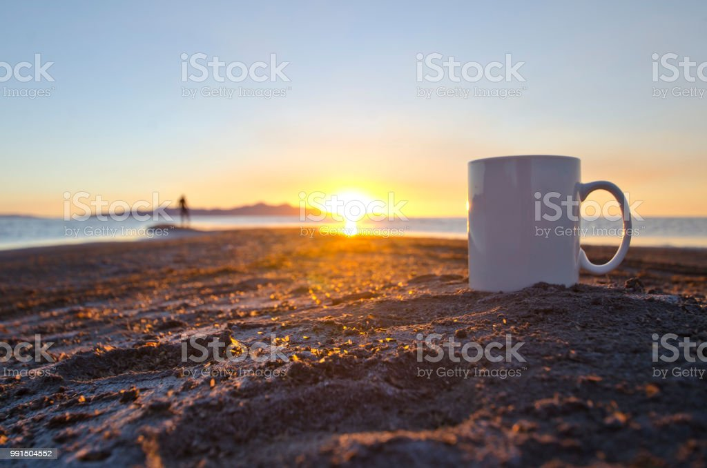 A lone man and a solo blank white coffee mug stock photo