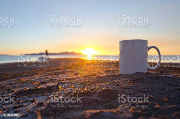 Photo of A lone man and a solo blank white coffee mug