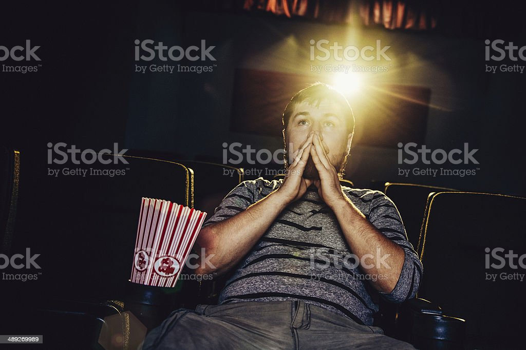 Lone man at the movies stock photo