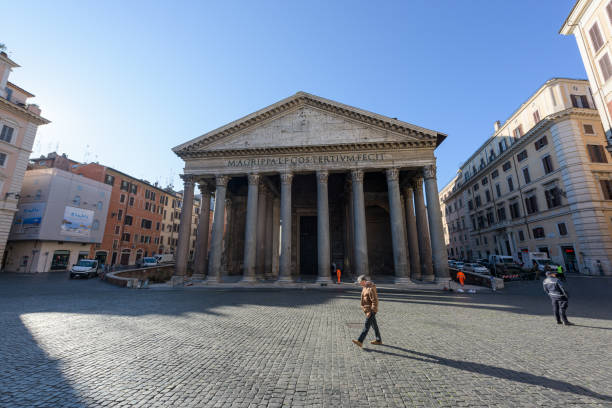 A lone man walks across the deserted Pantheon square stock photo