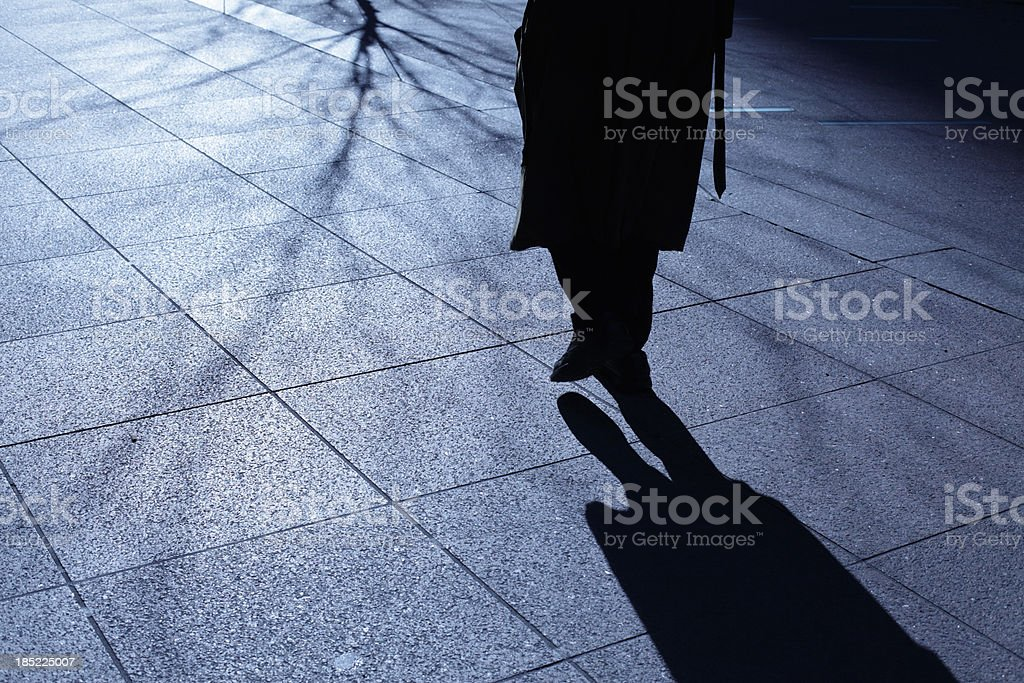 Lone old man walking in blue night shadows royalty-free stock photo