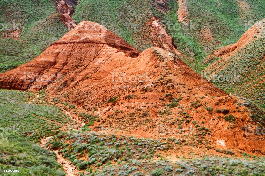 Lone red clay mountain stock photo