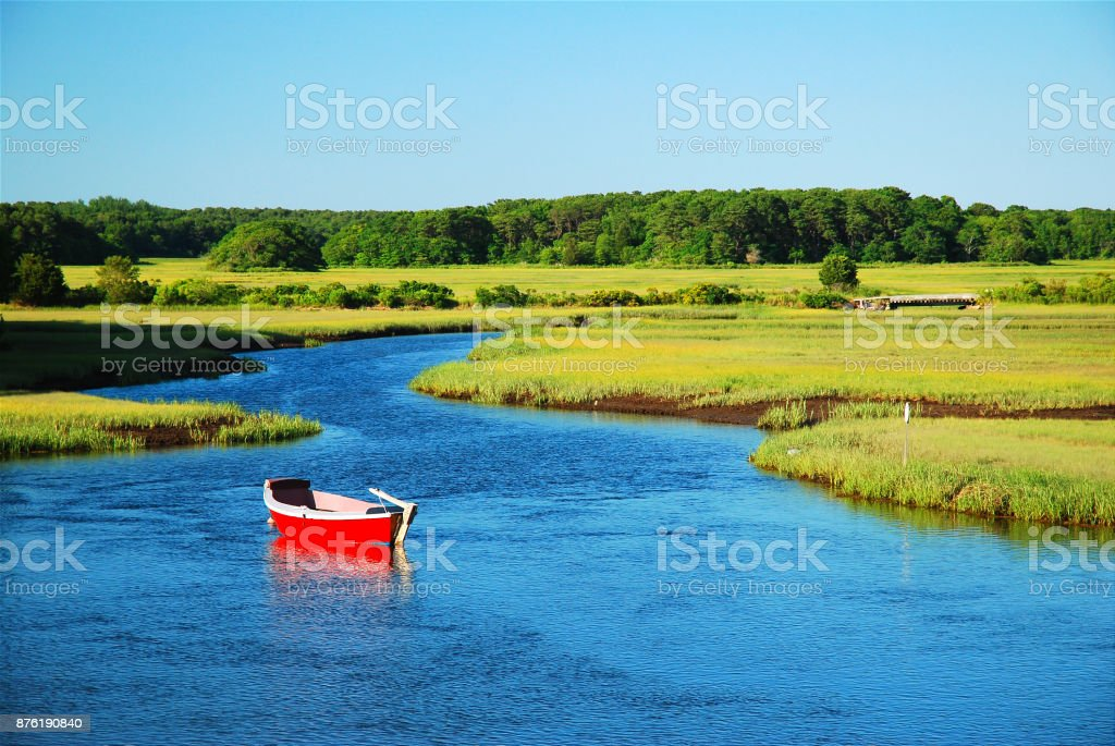 Lone red dinghy stock photo