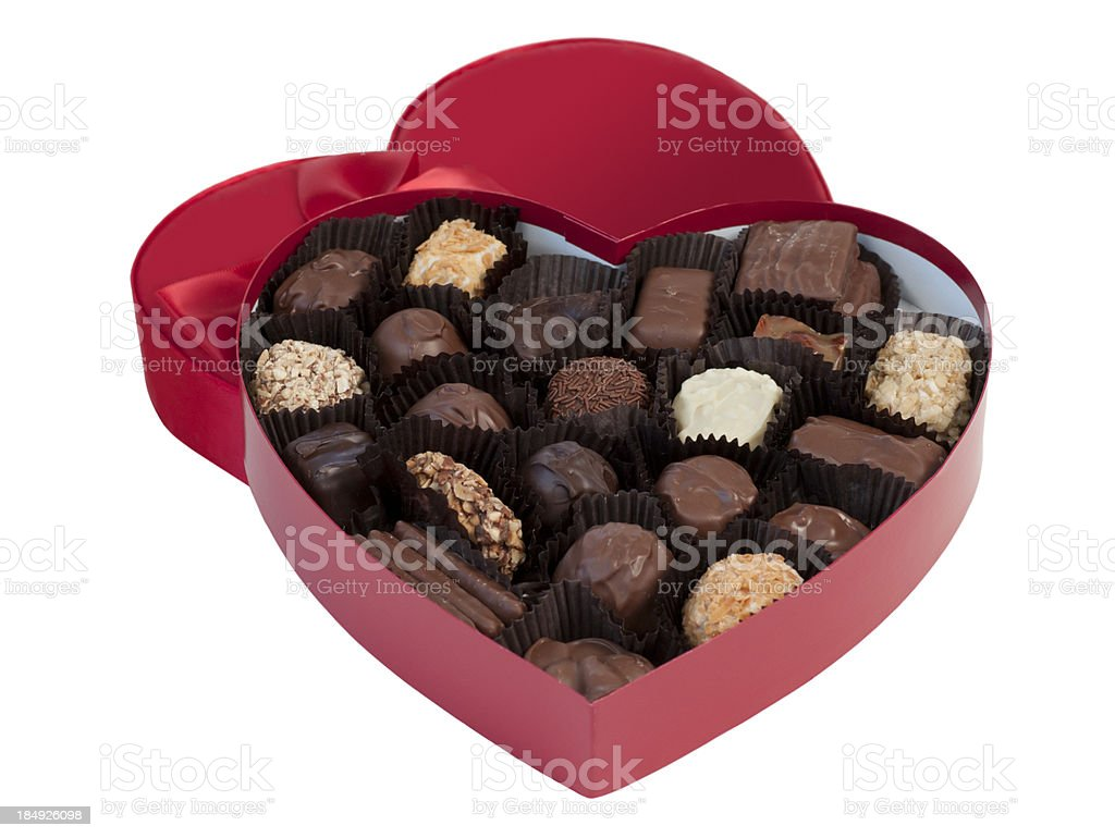 Lone red Valentine's chocolate box over a white background stock photo