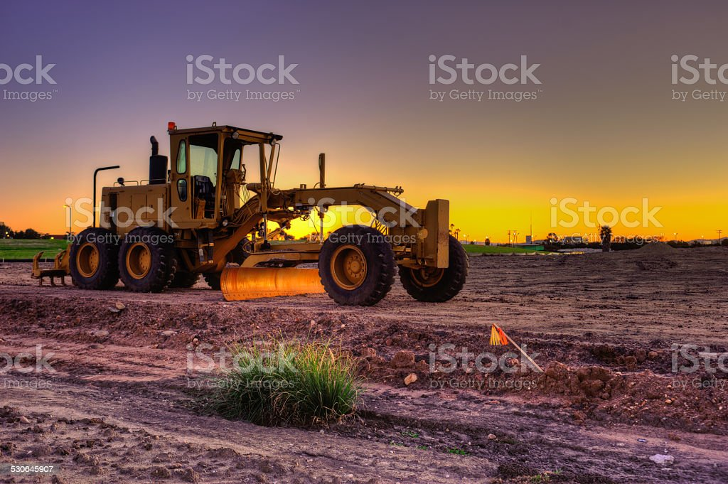 Lone road grader on the jobsite stock photo