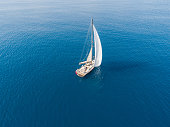 A lone sailing boat at anchor aerial view