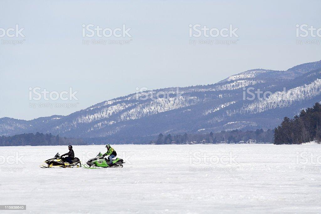 Lone Snowmobiles royalty-free stock photo