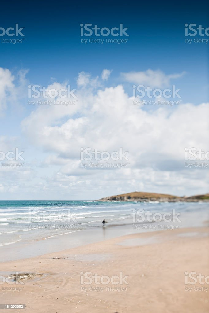 Lone Surfer on Fistral Beach stock photo