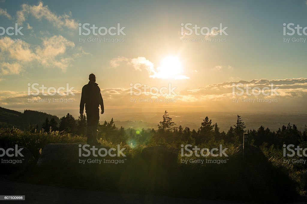 lone traveller above the clouds stock photo