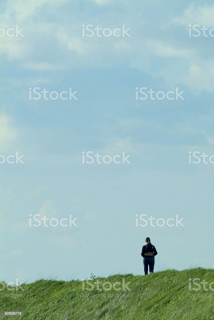 Lone walker, sky backdrop royalty-free stock photo
