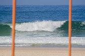 istock lone wave breaking during the coronavirus pandemic in Rio de Janeiro 1248302779