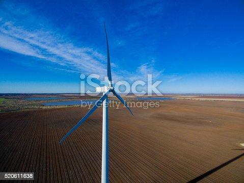 892160114 istock photo Lone windmill standing tall 520611638