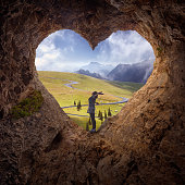 istock Lone woman in heart shape cave towards the idyllic scenery 873620080