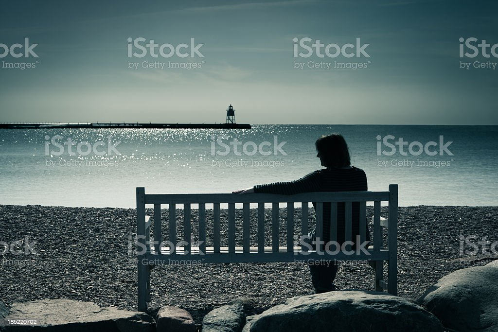 Lone Woman, Widowed, Divorced, or Lonely, Contemplating Grief, Sadness, Depression stock photo