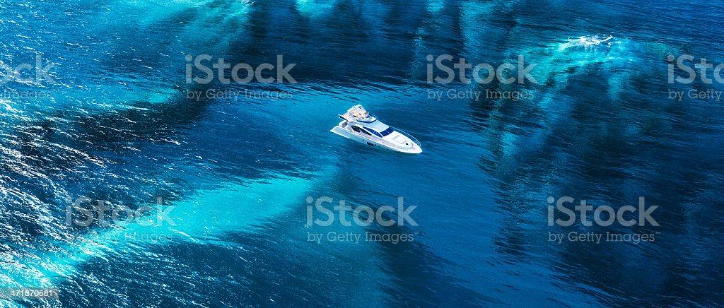 Lone yacht at sea stock photo