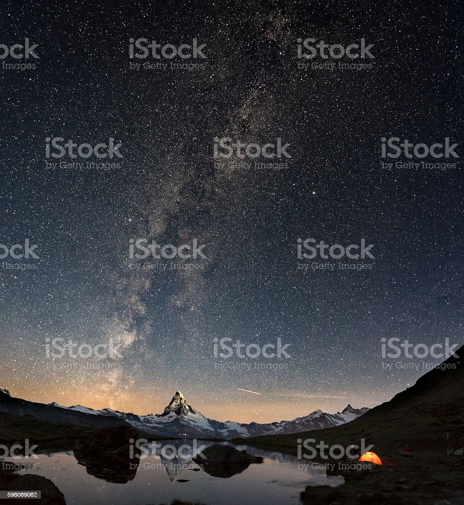 Loneley Tent under Milky Way at Matterhorn stock photo