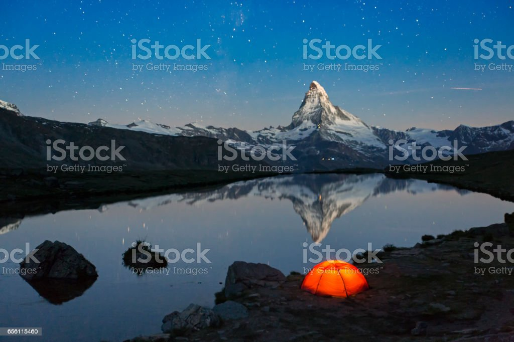 Loneley Tent under stary sky at Matterhorn stock photo
