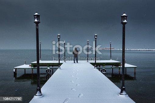 A man standing on a pier near Lake Van, Turkey.