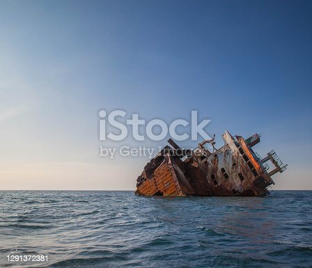 istock Lonely abandoned ship sea 1291372381