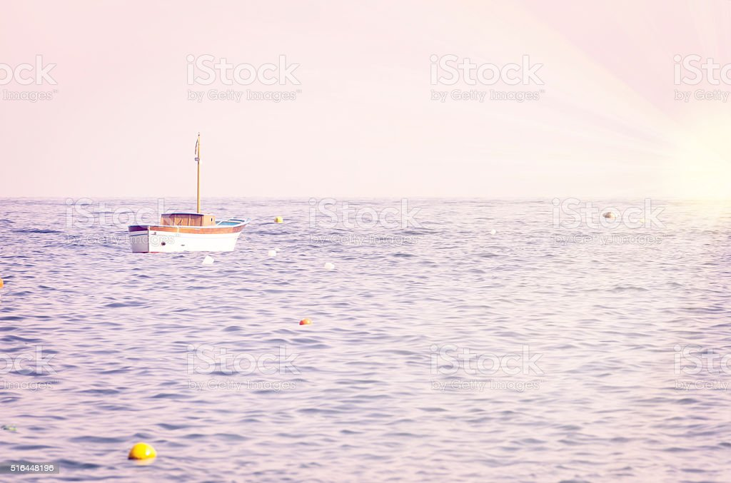Lonely anchored boat in the sea stock photo