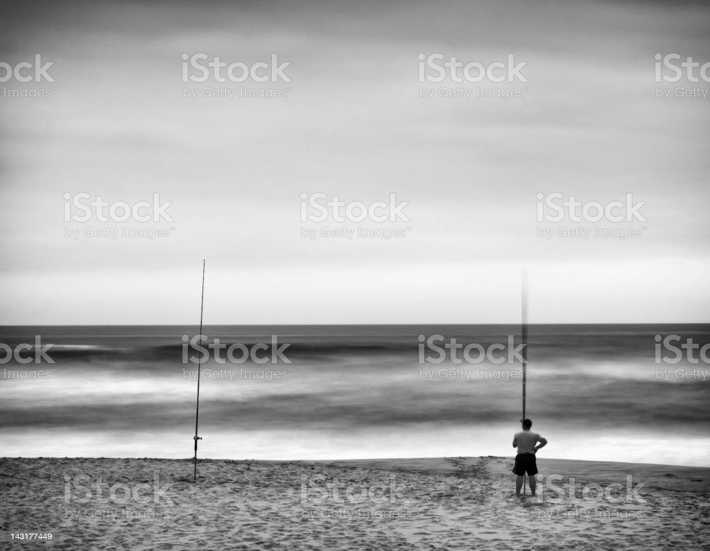 Lonely and patient fisher royalty-free stock photo