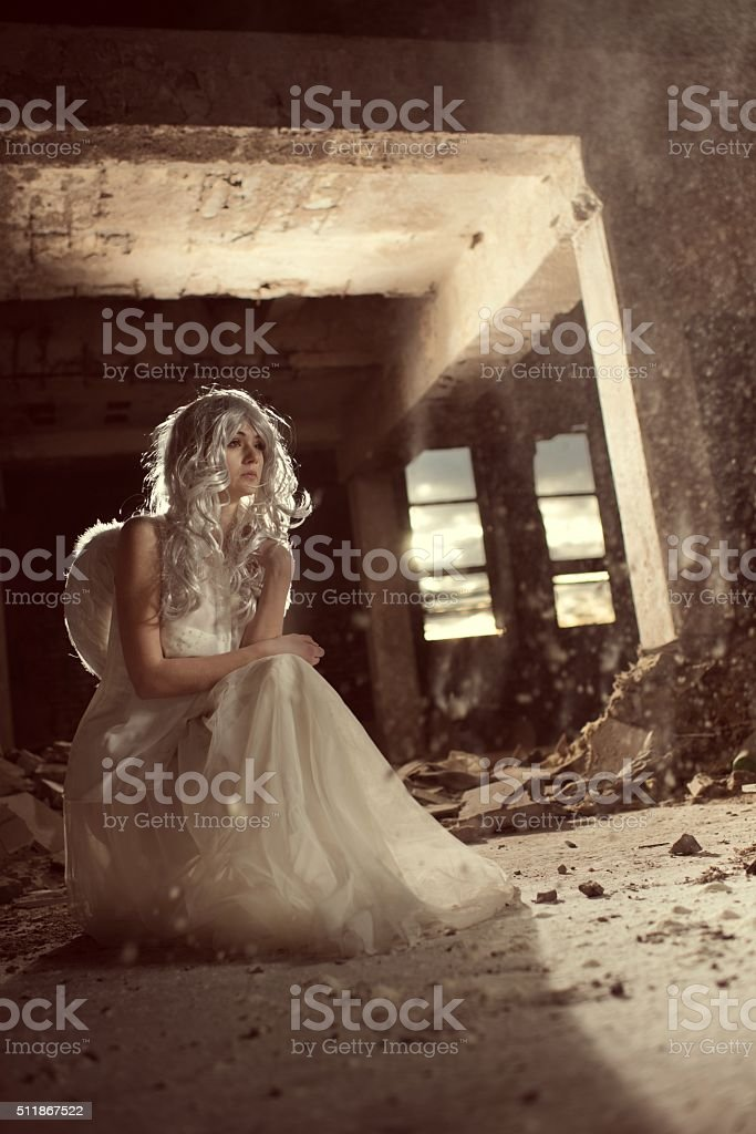 Lonely angel in a ruin. stock photo