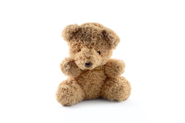 einsamer bär puppe isolieren - kinderspielzeug stock-fotos und bilder