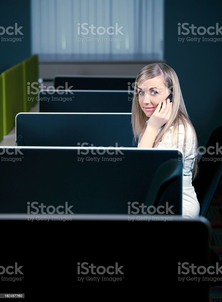 Lonely beautiful businesswoman talking on mobile phone royalty-free stock photo