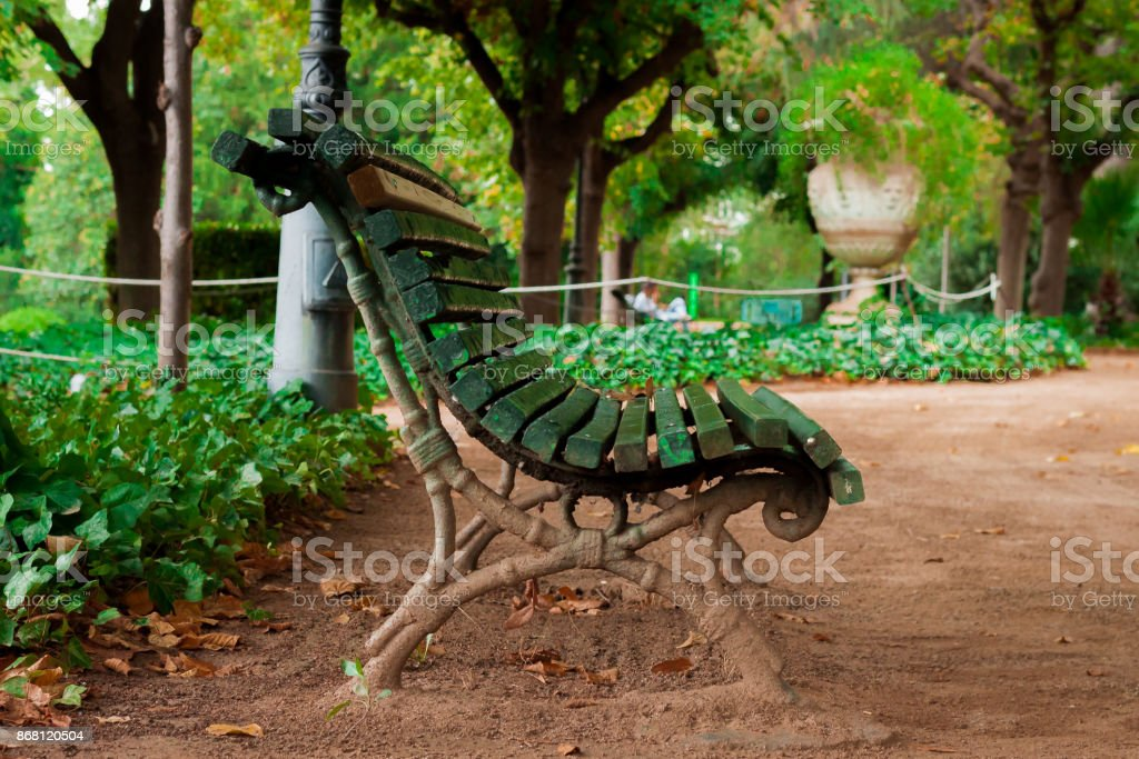 A lonely bech in a beautiful garden stock photo