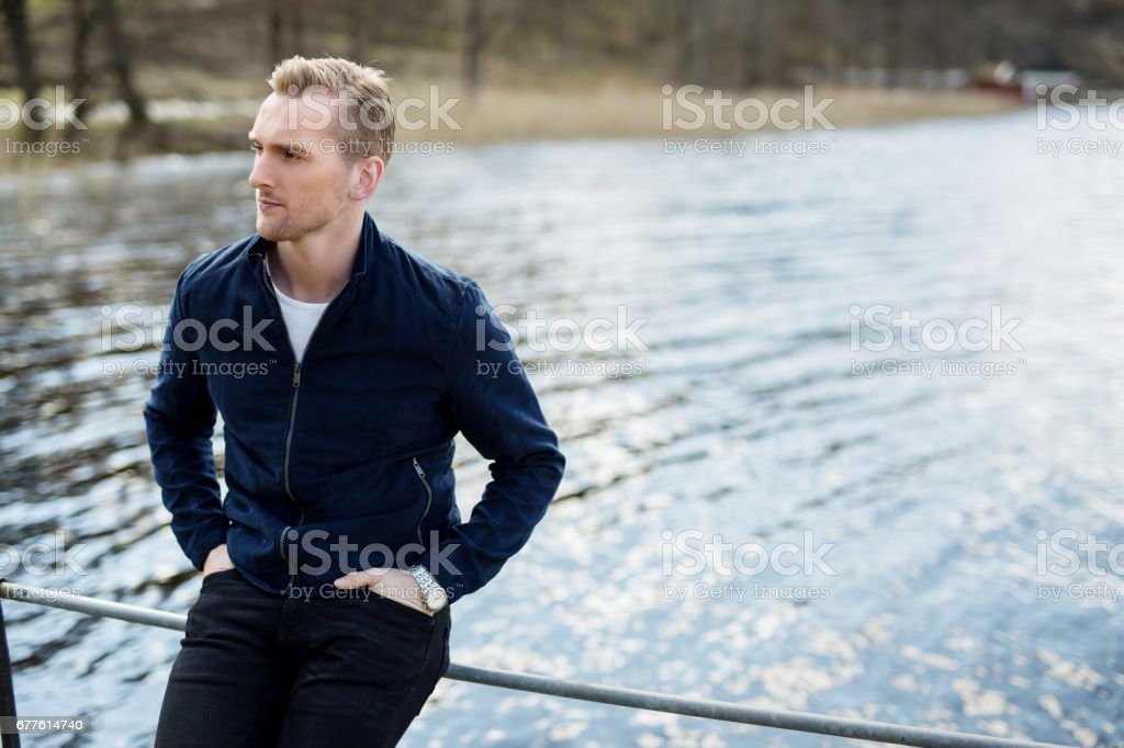 Lonely blonde man outdoors stock photo
