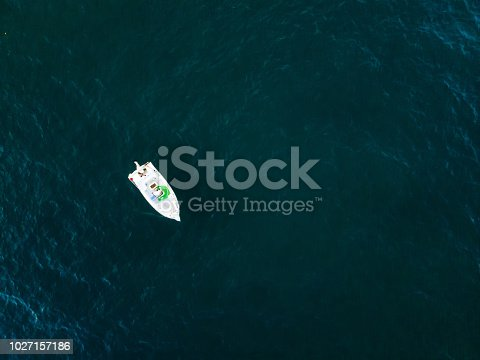 811600544 istock photo Lonely boat anchored in the sea 1027157186