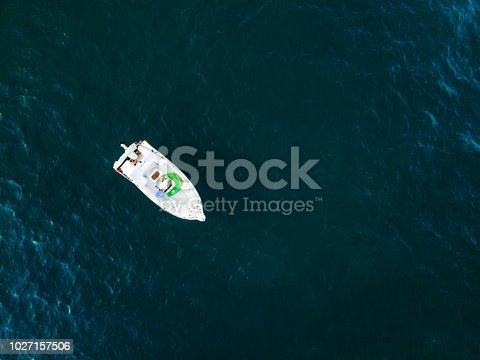 811600544 istock photo Lonely boat anchored in the sea 1027157506