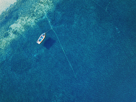 istock Lonely boat anchored in the sea 811600544