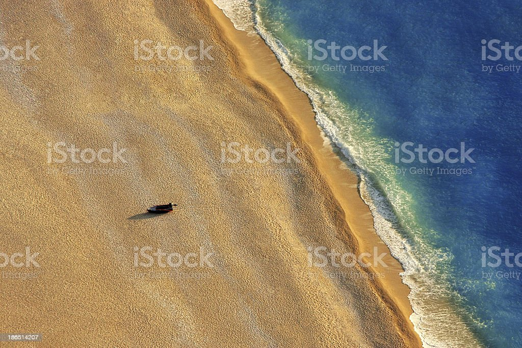 Lonely Boat on a Beach royalty-free stock photo