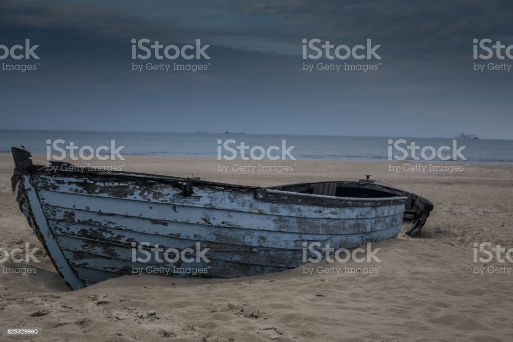 lonely boat on the beach stock photo