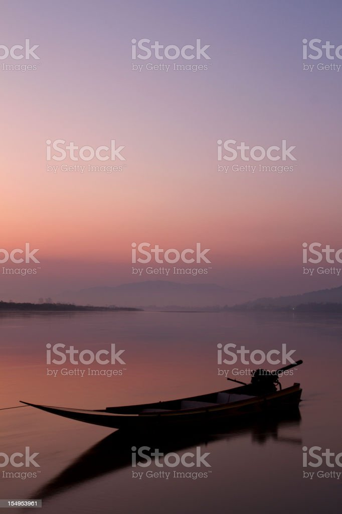Lonely boat on the Mekong river in Thailand stock photo