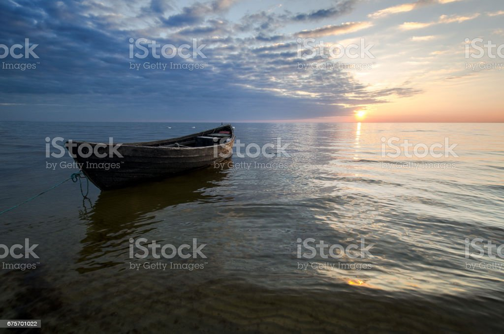 Lonely boat on the sea at sunset. royalty-free stock photo