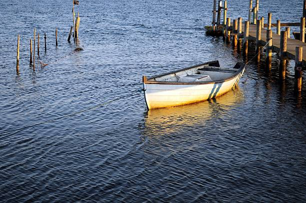 Lonely boat on the water stock photo
