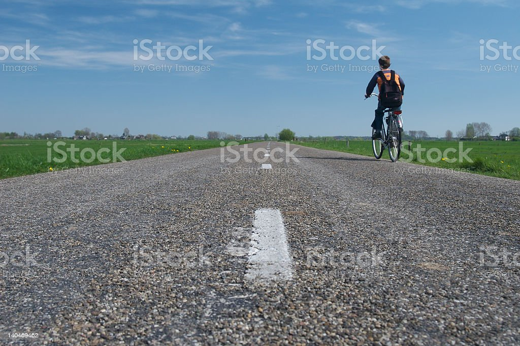 Lonely boy in empty road stock photo
