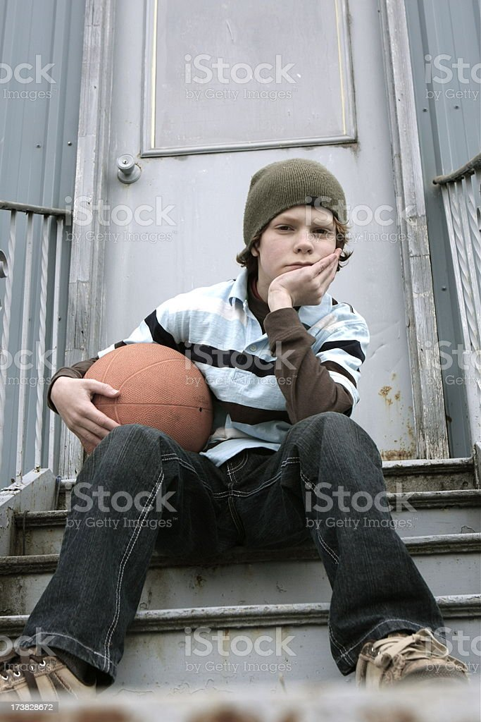 Lonely Boy with Basketball royalty-free stock photo