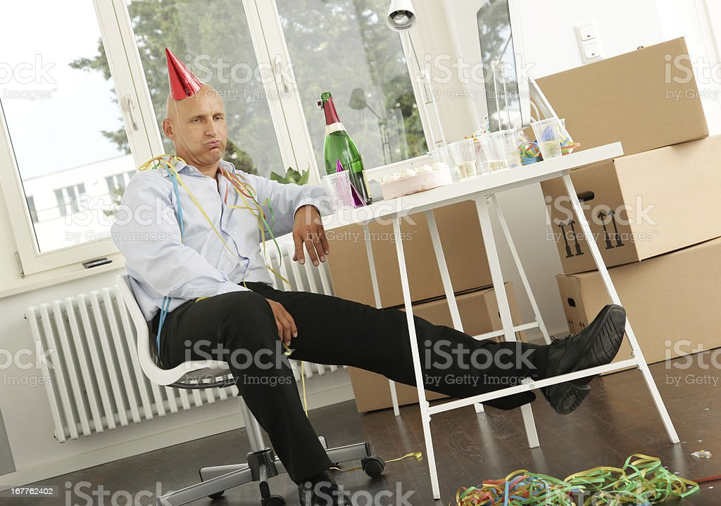 Lonely Businessman - After the Party stock photo