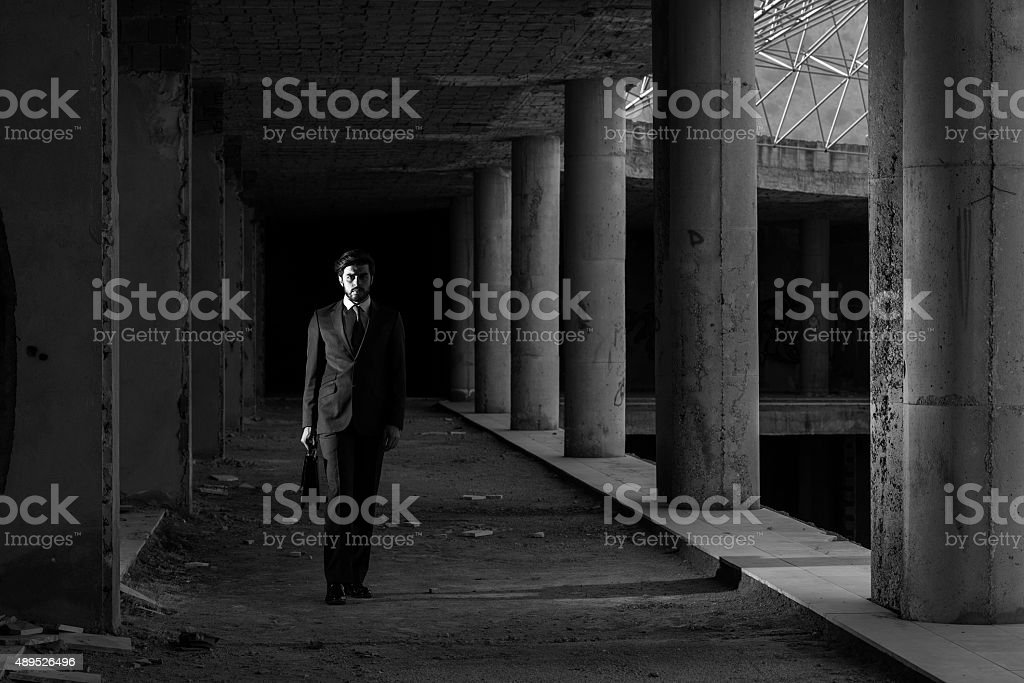Lonely Businessman In Abandoned Modern Building stock photo