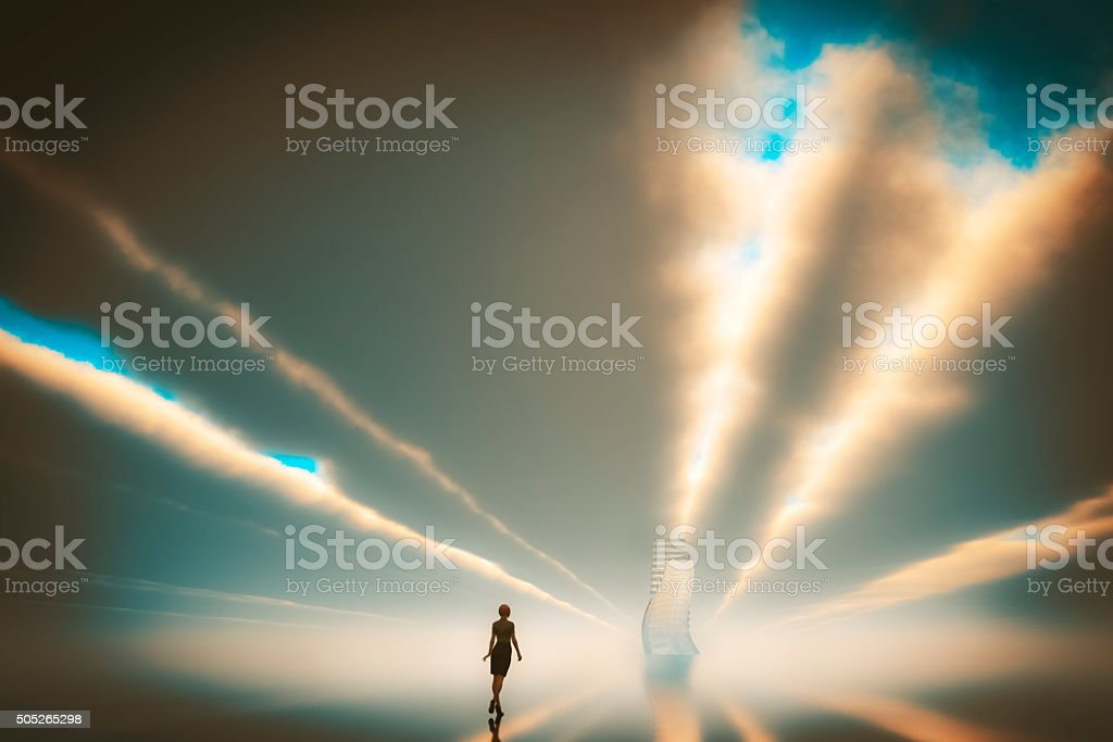 Lonely businesswoman walking towards sunset stock photo
