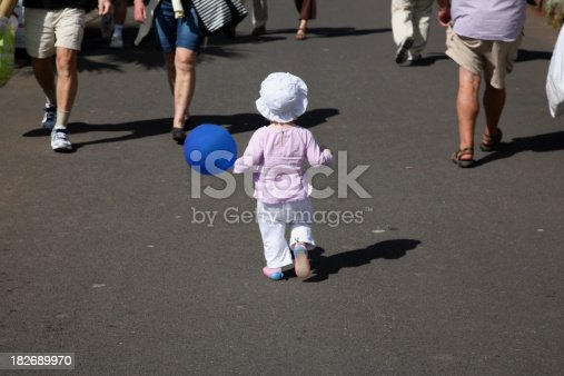Close up of young child looking for his mother in the crowd. High resolution.